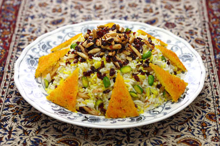 zereshk polo with tahdig, saffron barberry rice with scorched rice, iranian persian cuisine 스톡 콘텐츠