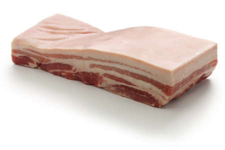 raw pork belly with rind isolated on white background 版權商用圖片