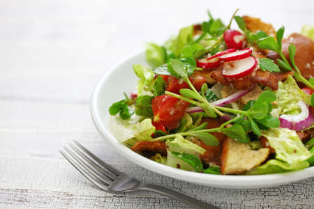 fattoush salad with sumac and pita bread, Lebanese cuisine