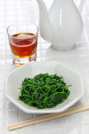 Chinese white wine stir fried with toothed bur clover, shanghai cuisine Stock Photo