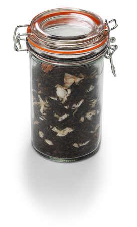 making jasmine tea, green tea with arabian jasmine flower in glass jar