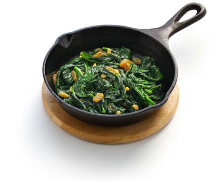 sauteed spinach with raisins and pine nuts, spanish catalan dish Banco de Imagens