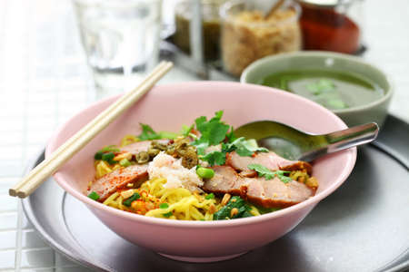 bami haeng mu daeng, egg noodles served with roast pork, thai food
