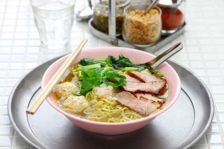 bami nam, egg noodles soup served with roast pork, thai food