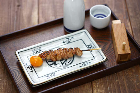 Japanese grilled chicken skewers, very rare chouchin (immature egg yolk)