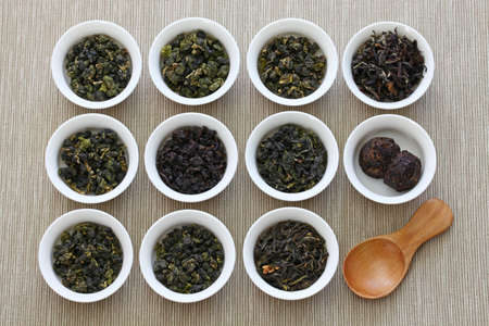 Taiwanese tea assortment: iron goddess tea, oolong tea and pu-erh tea 스톡 콘텐츠 - 113853317