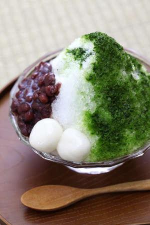 Ujikintoki kakigori, japanese shaved ice with matcha green tea syrup and azuki red beans jam isolated on white Stock Photo