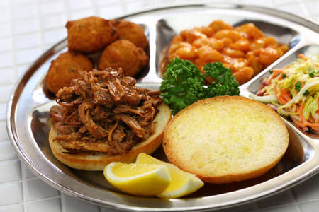 North Carolina barbecue; pulled pork, hush puppies, baked beans and coleslaw