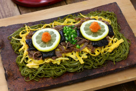 Kawara soba, japanese local food, fried green tea buckwheat noodles on the roof tile