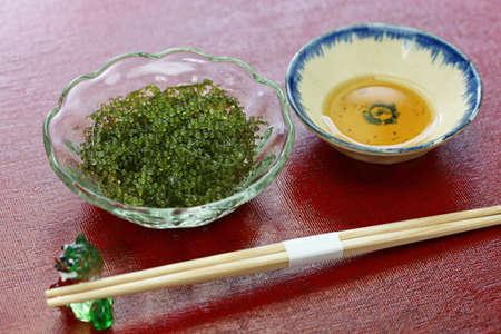 umi budo, green caviar, sea grapes, seaweed, edible algae on the table Stok Fotoğraf