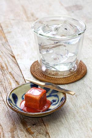 tofuyo, hard tofu dipped in red malt and awamori, japanese okinawa delicacy food