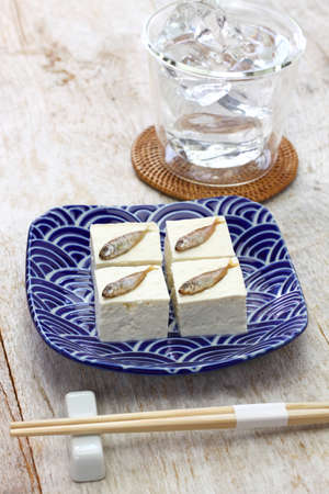 Sukugaras Tofu is a Japanese Okinawan delicacy that is the salted young rabbitfish putting on Okinawa Tofu.