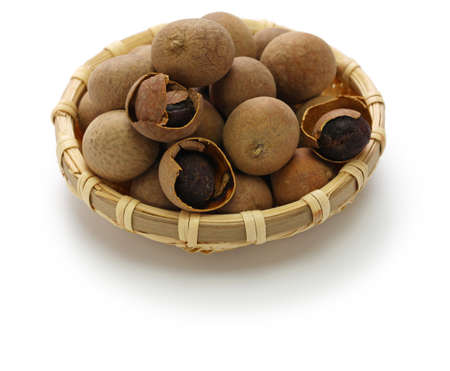 dried longan fruits isolated on white background
