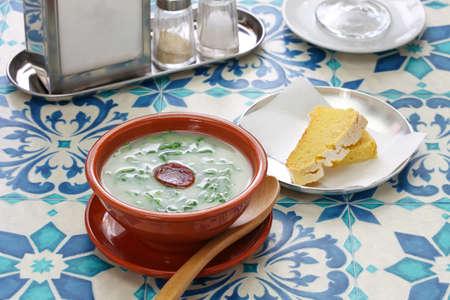caldo verde (kale soup) & broa (corn bread), portuguese traditional cuisine Stock fotó