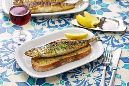 sardinhas assadas, portuguese grilled sid on toasted bread