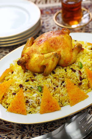 zereshk polo ba morgh, barberry rice with saffron chicken, iranian persian cuisine