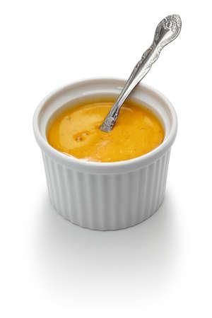 homemade rouille sauce in ramekin isolated on white background Stock Photo
