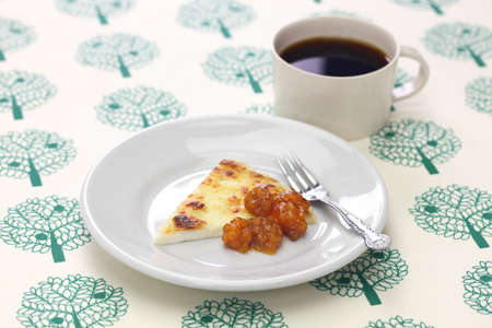 homemade finnish squeaky cheese (leipajuusto) with cloudberry jam (lakkahillo) and a cup of coffee Stock Photo