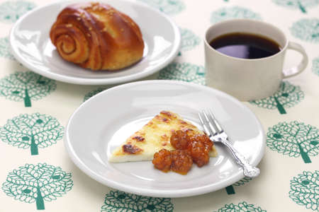 homemade finnish squeaky cheese (leipajuusto) with cloudberry jam (lakkahillo), a cup of coffee and cinnamon roll