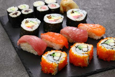 japanese sushi assorted : california rolls, maguro(tuna), salmon, futomaki(sushi burrito), negitoro(minced tuna roll), takuan(pickled daikon radish), kanpyo(dried gourd), kappa(cucumber), gari(pickled