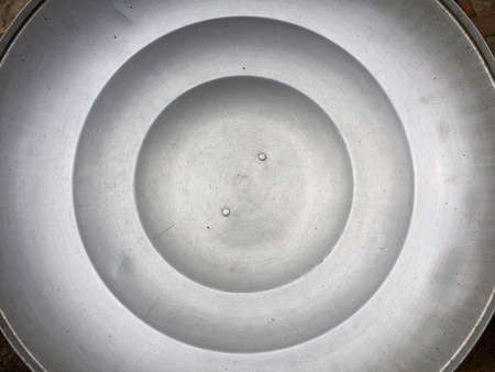 silver: Pot lid background Stock Photo