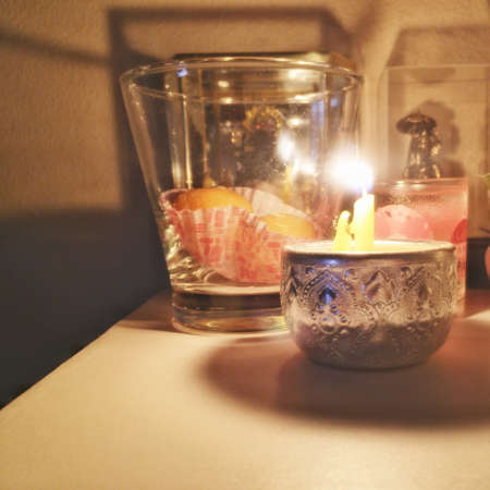hope: Burning candle in silver cup Stock Photo