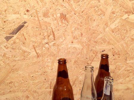 illustration: Bottle isolated on wood background