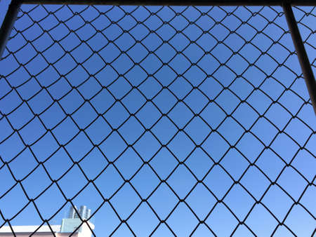 net: Iron net isolated on sky