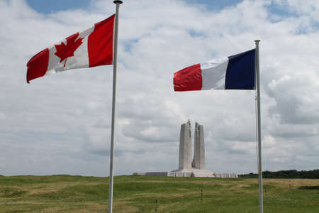 Canadian and French flags at Vimy Ridge Memorial France photo