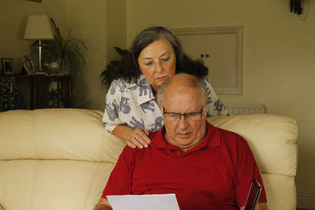 togther: Senior couple looking at a document