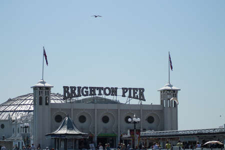 sightseers: Entrance to Brighton Pier