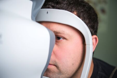 tonometer: The ophthalmologist conducts the research with the help of various equipment, a contactless tonometer, for the diagnosis of eye disease Stock Photo