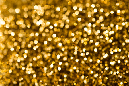Christmas gold background with circles in bokeh Фото со стока