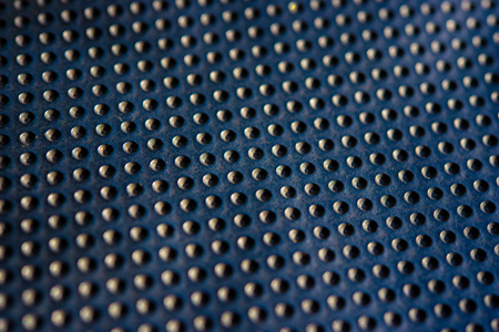 dotted texturised technological seamless fabric or surface closeup