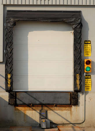 industrial transport truck loading dock with green light on Stock Photo