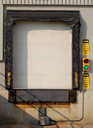 industrial transport truck loading dock with green light on Reklamní fotografie