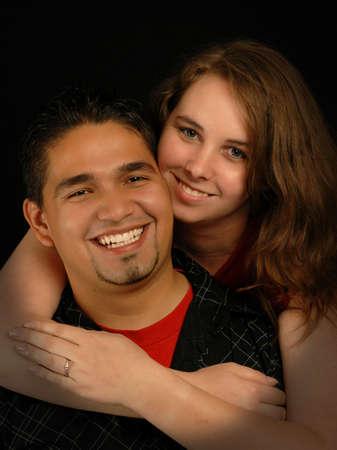 beautiful young engaged spanish caucasian ethnic mixed couple