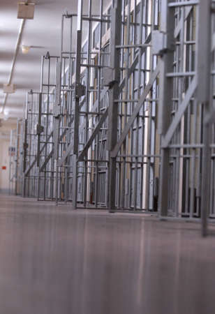 row of open jail cells or a cell block Imagens - 3962076