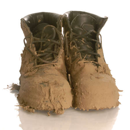 muddy work boots isolated on a white background Stock Photo