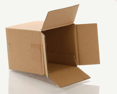 empty cardboard box tipped over isolated on white background