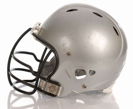 scratched football helmet with reflection on white background Stock Photo
