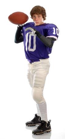 teenage boy wearing football uniform on white background