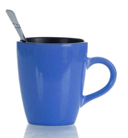 blue and black coffee mug with spoon