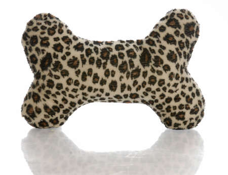 leopard print stuffed dog bone with reflection on white background