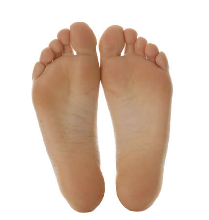 female soles: adult size feet isolated on white background Stock Photo