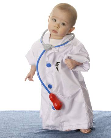 seven month old baby dressed up like a doctor on white background photo