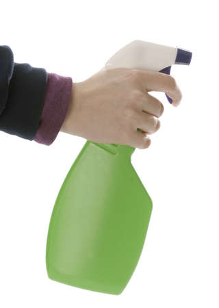 persons hand pulling trigger of spray bottle isolated on white background