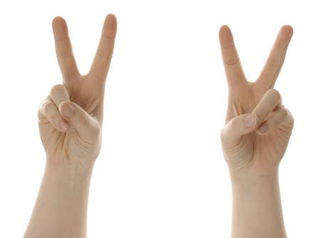 two hands giving peace or victory symbol isolated on white background Stock Photo - 6462687