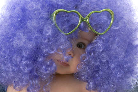 seven month old baby wearing clown wig with heart shaped glasses photo