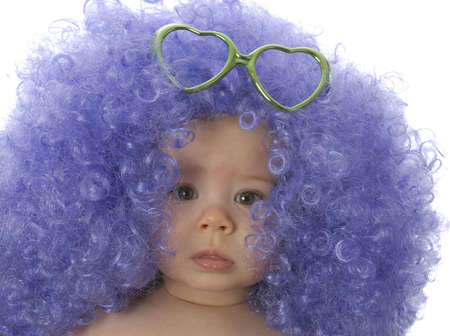 fancy dress costume: seven month of baby wearing clown wigh with heart shaped glasses